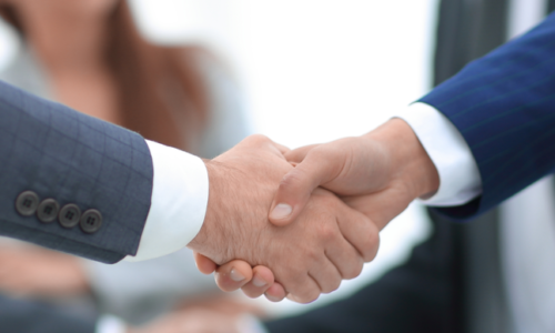 close up.business men shaking hands